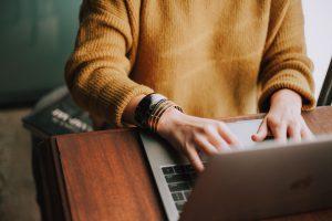 employee typing on laptop
