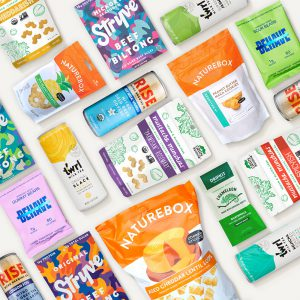 product grid flatlay image of various naturebox and third party branded snacks and drinks