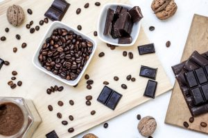 flatlay of nuts, chocolate, and coffee