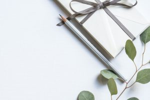 flatlay of wrapped gift with pencil